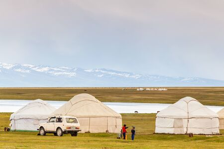 SONG KUL, KYRGYZSTAN - CIRCA JUNE 2017: View of one of the camps at Song Kul  high alpine lake in the Tian Shan Mountains of Kyrgyzstan circa June 2017 in Song Kul. Editorial