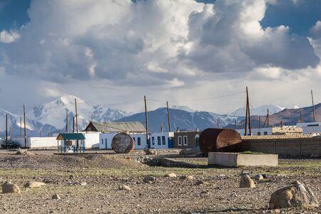 KARAKUL, TAJIKISTAN - CIRCA JUNE 2017: Beautiful view of Karakul village on Lake Karkul in Tajikistan circa June 2017 in Karakul. Editorial