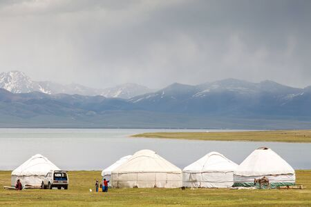SONG KUL, KYRGYZSTAN - CIRCA JUNE 2017: View of one of the camps at Song Kul  high alpine lake in the Tian Shan Mountains of Kyrgyzstan circa June 2017 in Song Kul. Sajtókép