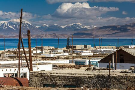 KARAKUL, TAJIKISTAN - CIRCA JUNE 2017: Beautiful view of Karakul village on Lake Karkul in Tajikistan circa June 2017 in Karakul. Sajtókép