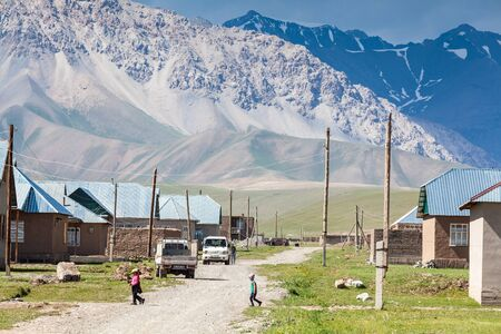 SARY-MOGUL, KYRGYZSTAN - CIRCA JUNE 2017: View on Sary-Mogul a village of around 3000 people on the north side of the Alay Valley in southern Kyrgyzstan circa June 2017 in Sary-Mogul.