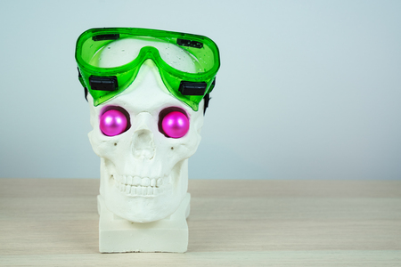 Snorkeling scuba diving skull sculpture with pink eyes with mask