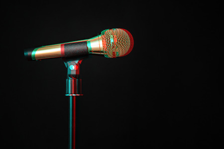 gold microphone on stage on a black background. Digital signal  glitch effect (rgb shift, slices). Screen error