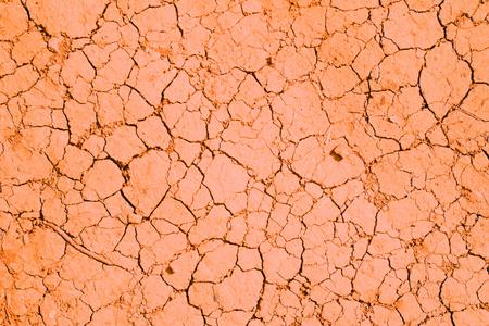 Orange сracks texture ground surface soil, drought, dried clay,  ground on Mars