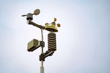 Meterological weather station wind meter anemometer on sky background