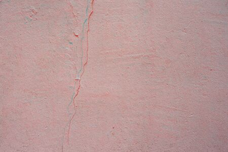 Old pink wall with crack and plaster. textured background. Digital signal  glitch effect (rgb shift, slices). Screen error