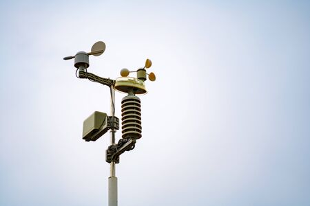 Weather station instruments against sky background