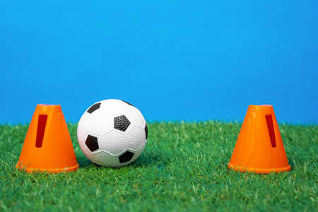 Two plastic cone restraints stand depicting a soccer goal Stock Photo