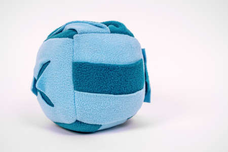 soft educational toy for a child in the shape of a ball on a white background Stock Photo