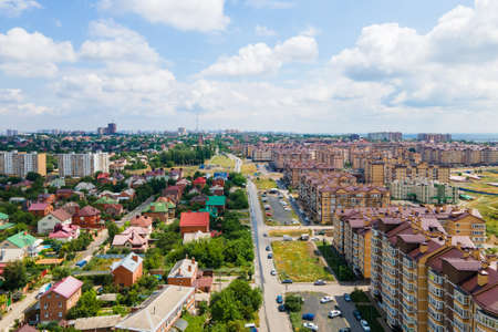 Shooting by drone city park, buildings and new residential area of town. Urban landscape from bird eye view