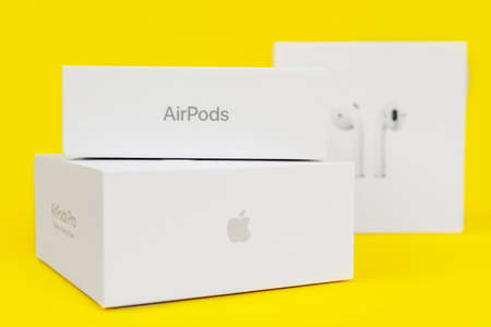 RUSSIA ROSTOV - MAY 29 2021: Three closed boxes for Apple digital devices stacked on top of each other on yellow background, side view, copy space for advertising text. A fan of the brand Editorial