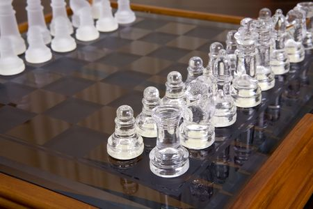 sandblasted: Glass and sandblasted chess pieces on glass chessboard with wooden frame