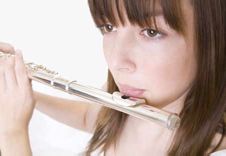 elective: Closeup of a teenager girl who is palying flute. White background