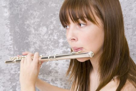 rehearse: Close up of a teenager girl playing flute