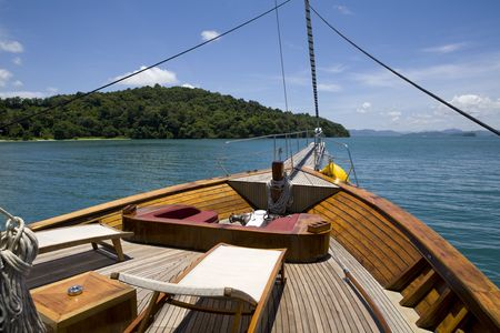Front deck of yacht with chairs sailing in the ocean Stock Photo