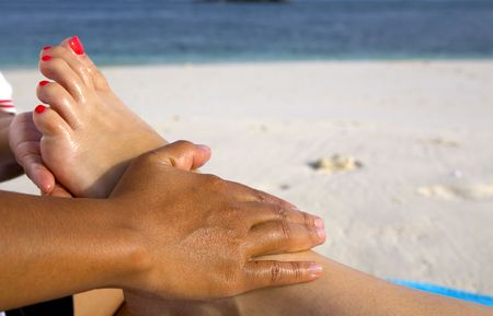 A foot massage on the beach Stock Photo - 3594069