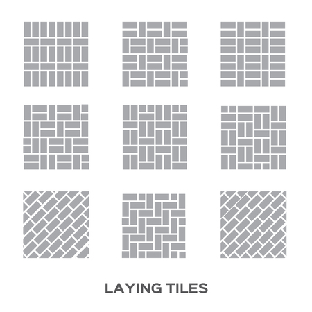 tiling: Man tiling a wall in the room