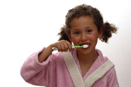 The girl cleans a teeth photo