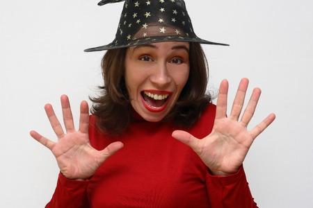 joyfully: Joyfully surprised witch in a black hat on a white background