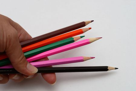 The hand holds color pencils Stock Photo - 1832742