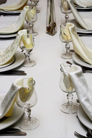 Lines of glasses with napkins at restaurant Stock Photo