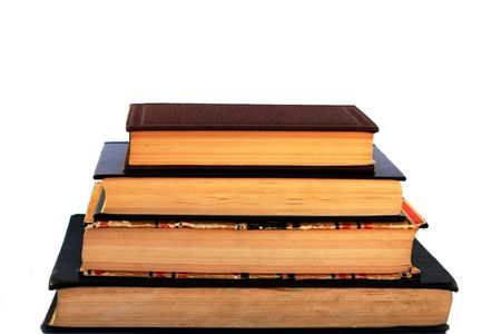 bibliomania: Pile of four old books on white background