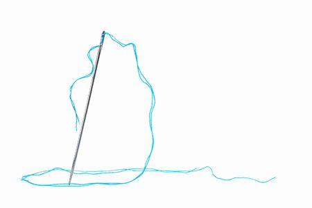 needle and turquoise thread on white background