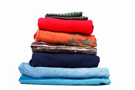Stacks of colored clothes on white background