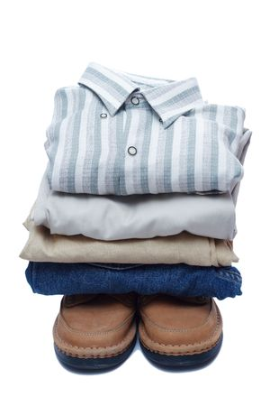 fold: Stacks of manly colored clothes on white background