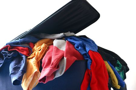 messy clothes: luggage overstuffed and packing to travel (isolated on white background).