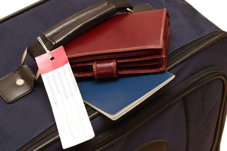 travels set - suitcase, passport and wallet. Stock Photo
