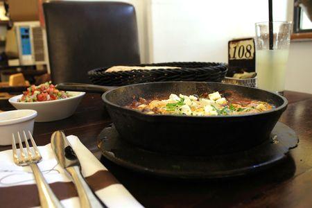Breakfast - omelette, salad, juice in cafe Stock Photo