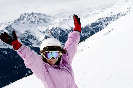 ski slopes: Teenager girl on ski vacation (mountain sun landscape) Stock Photo