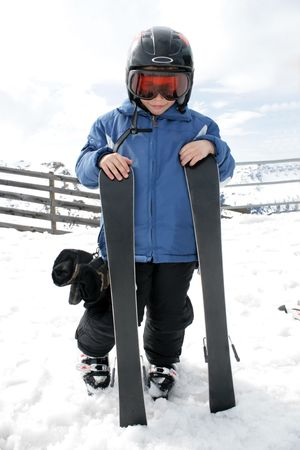 Boy on ski vacation (mountain sun landscape)