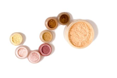 Set of multicoloring powder and other cosmetics (isolated on white) Stock Photo