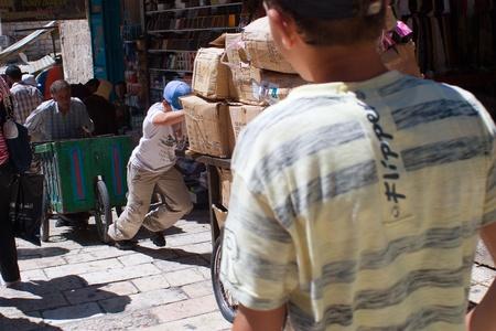 Old City, Jerusalem, Israel - July 17, 2009: boy and man driven  loaded carts Editorial