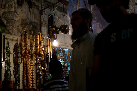 Old City, Jerusalem, Israel - July 17, 2009: Arabic Muslim Men go to prayer through tunnel to entrance gate to  Dome Of The Rock and Al-Aqsa