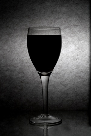 Winery goblet over textured background . Stock Photo