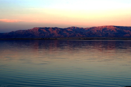 Sunset over Dead Sea, mountain view .