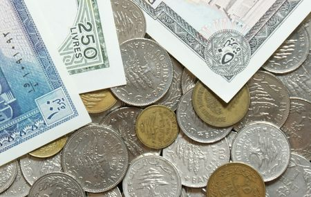 arabic currency: A collection of outdated lebanese coins and paper bills