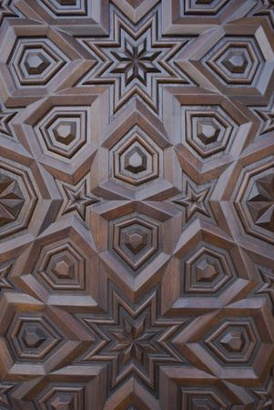 sculpt: An oriental or islamic design carved into dark brown wood Stock Photo