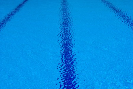 Swimming pools ripples generated by gentle winds photo
