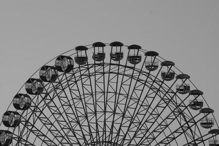 A black ferris wheel ona grey background Stock Photo - 6961033