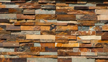 Mult colored stone tiles wall suitable for a background photo