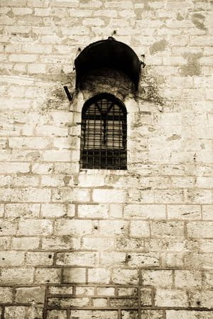Lonely prison window on a high wall Stock Photo - 7646659