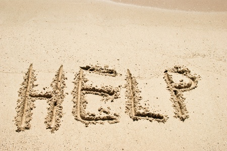 sand drawing: Help Sign on the beach Stock Photo