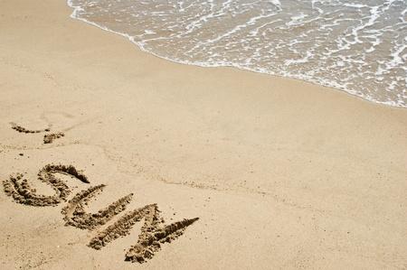 Summer and sun word on the beach Stock Photo - 8598629