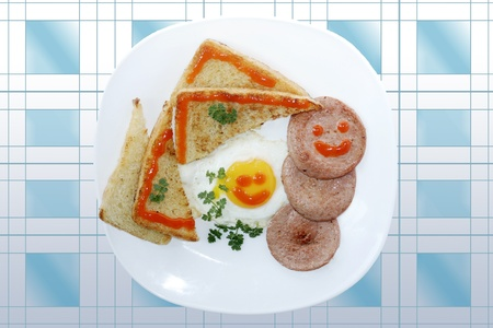Tasty breakfast from fried eggs and toasts  Smiled food serial  photo