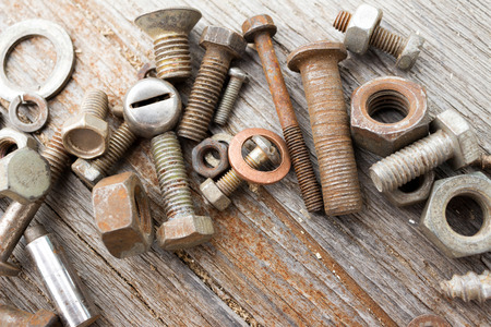 bolts and nuts: Photo of nuts, bolts on a shabby wooden background