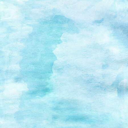 Beautiful light blue watercolor texture on wet paper